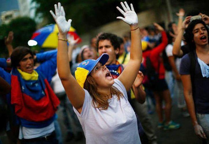 Opositores al gobierno de Nicolás Maduro han tomado las calles de Caracas, Venezuela. (Milenio)
