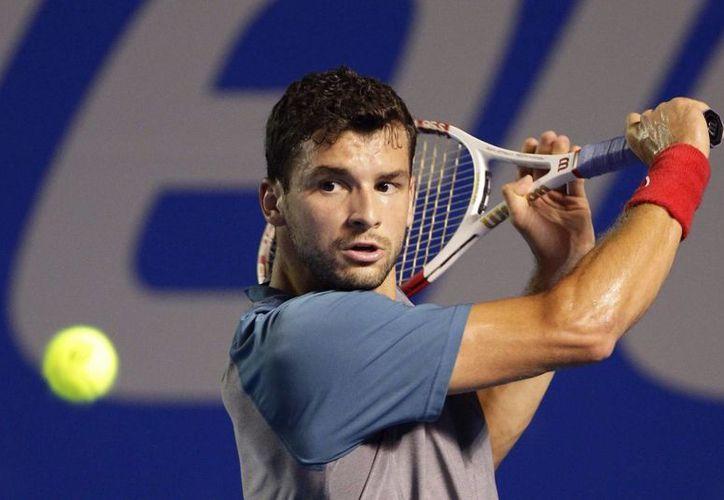 Dimitrov, de 22 años de edad y número 22 del mundo, va apenas por el segundo título de su carrera. (EFE)