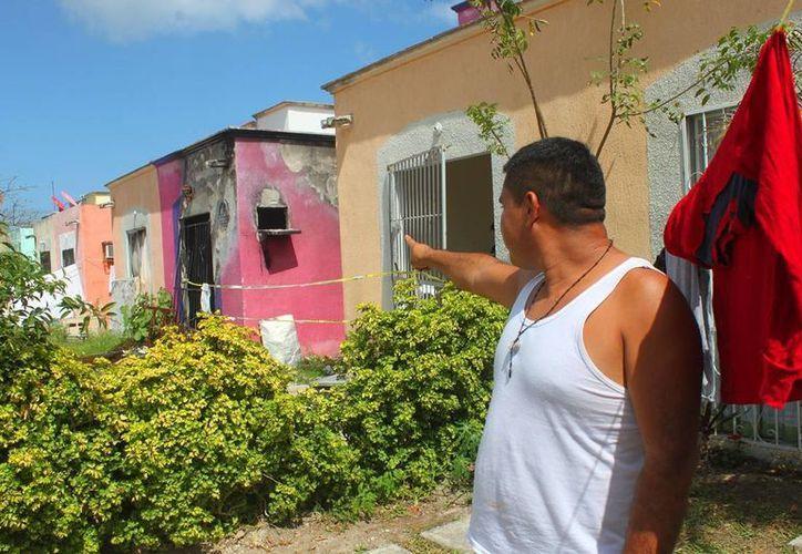 Las casas dañadas por la explosión de tanques de gas en diciembre pasado siguen sin ser demolidas. (Daniel Pacheco/SIPSE)