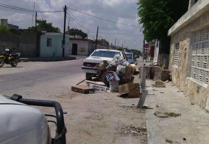 En Progreso los habitantes están dispuestos a dejar sin criaderos al mosco del dengue. (Óscar Pérez/SIPSE)