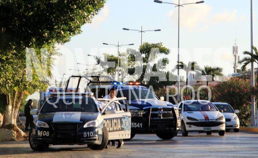 Las autoridades policíacas buscan a los responsables del ataque a la Fiscalía en Cancún. (Luis Soto/SIPSE)
