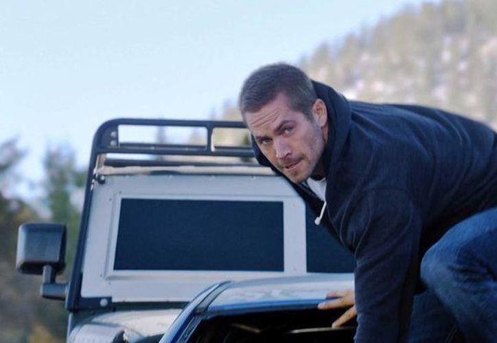 Fotografía de archivo sin fecha provista por los estudios Universal del actor Paul Walker en una escena de 'Furious 7'. (Foto AP/Universal Pictures, Archivo)