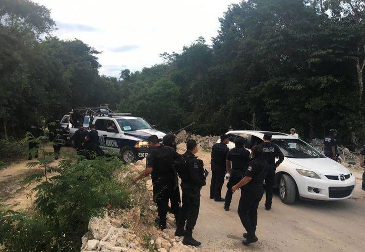 Varios elementos policíacos participaron en la búsqueda de los sujetos. (Redacción)
