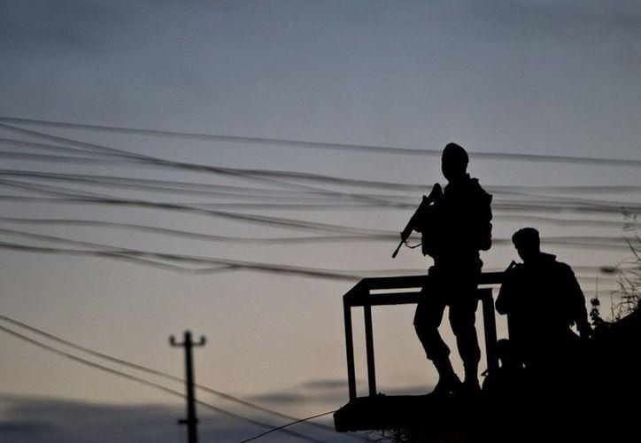 """Durante la operación también fue arrestado otro traficante, conocido como """"Perna"""", quien tomó tres rehenes para evitar ser capturado. (Archivo/EFE)"""