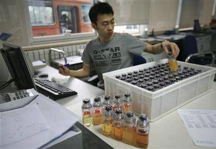 Los nuevos casos elevan a 98 la cifra total de atletas que han dado positivo a las pruebas de dopaje de Beijing 2008 y Londres 2012.(AP)