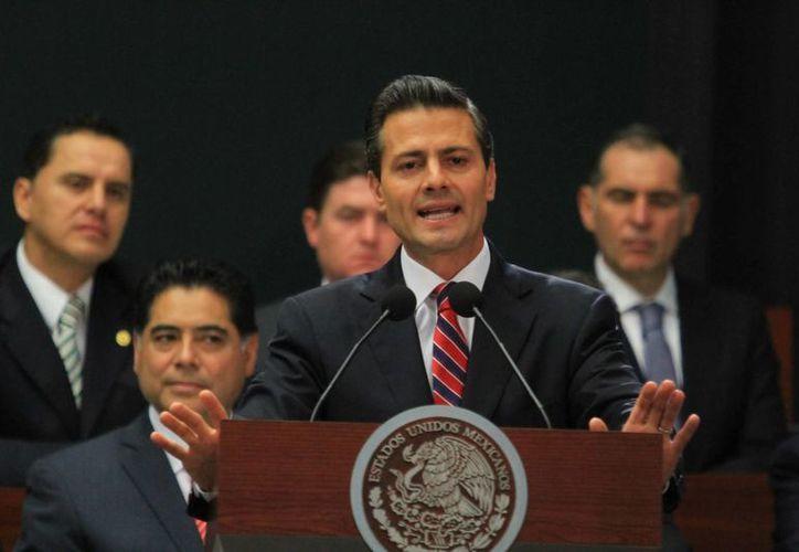 El presidente Enrique Peña Nieto durante su mensaje sobre la reforma hacendaria, en Los Pinos. (Notimex)
