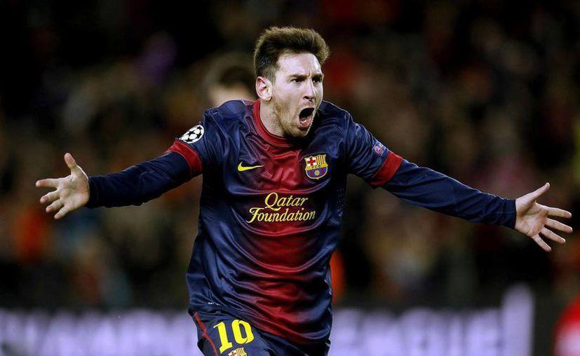 El nuevo tatuaje podría verse si Messi no sujeta sus medias del uniforme albiceleste debajo de sus rodillas. (EFE)