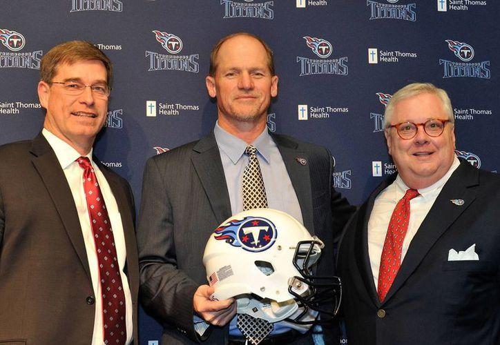 Ken Wisenhunt (c) no es más el coach de los Tennessee Titans. Fue despedido por malos resultados. (litbloc.com)