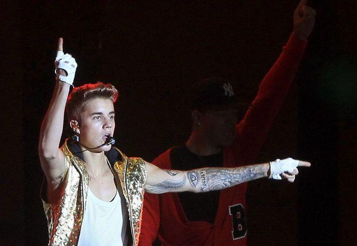 Al igual que en Colombia, Bieber salió de madrugada a realizar pintas en un muro de Río de Janeiro. (EFE/Archivo)