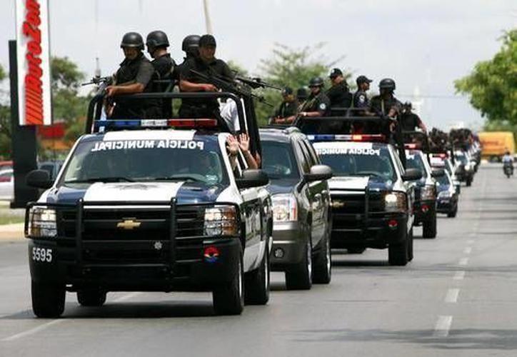 Andrés Manuel López Obrador asegura que la Ciudad de México, Tabasco y Quintana Roo tienen más policías que el promedio nacional. (Redacción/SIPSE)