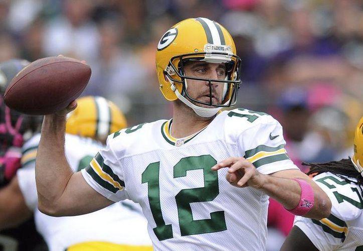 En el partido ante Green Bay, Aaron Rodgers lanzó un pase de touchdown de 64 yardas a Jordy Nelson. (Agencias)