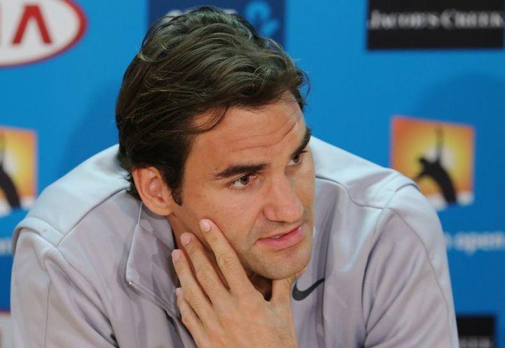Federer recordó que fue recogepelotas para Ferreira. (Foto: Agencias)