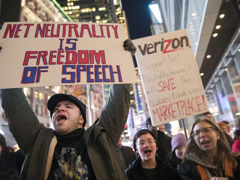 Demonstrators rally in support of net neutrality outside a Verizon store in New York.