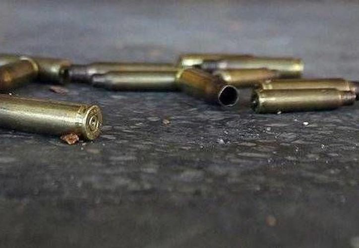 La pareja fue emboscada por pistoleros tras confundirlos con integrantes del crimen organizado y de un grupo contrario. (Archivo/Agencias)