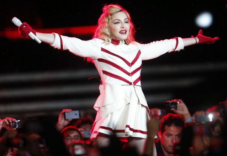 La reducción del repertorio de Madonna en el Estadio Nacional de Santiago de Chile se habría debido a riesgos por la intensa lluvia. (EFE)