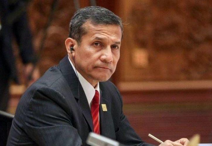 El presidente peruano, Ollanto Humala y el ex ministro argentino, Ricardo Jaime; aparecen implicados en el caso de Lava Jato.(EFE)