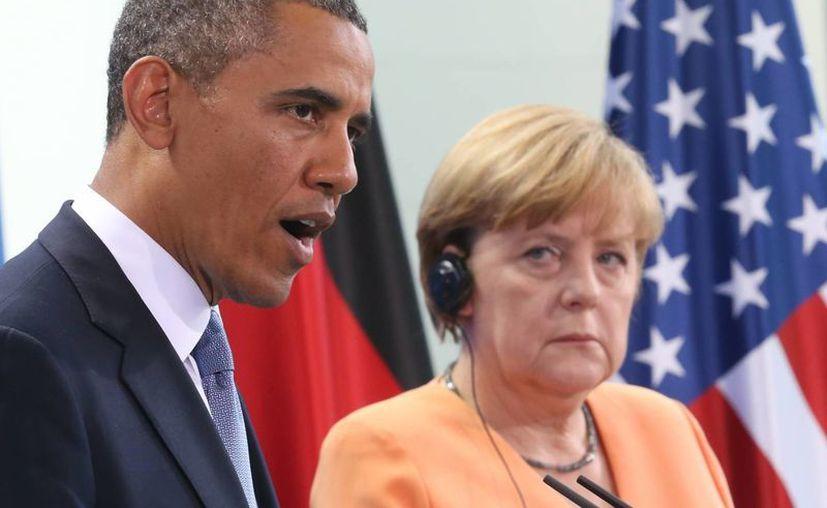 El presidente de Estados Unidos, Barack Obama, con la canciller alemana Angela Merkel, en imagen de junio de este año. (Agencias)
