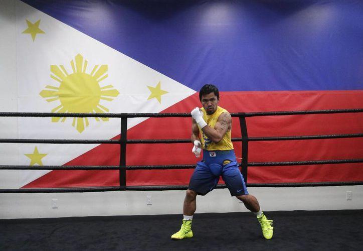 El filipino Manny Pacquiao durante un entrenamiento en Los Angeles previo a la pelea que sostendrá el sábado contra el norteamericano Floyd Mayweather Jr. (Foto: AP)