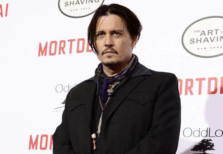 Sin duda Johnny Depp pasa por una mala racha, primero el escándalo con su aún esposa Amber Heard y el fracaso en taquilla, ahora con 'Alicia a través del espejo'. (Archivo AP)