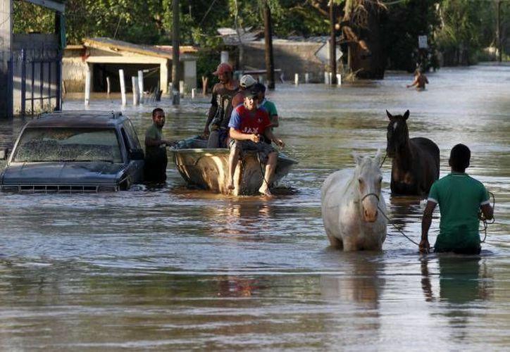 Los enseres y aparatos electrodomésticos fueron enviados para los damnificados de la tormenta tropical 'Mnauel', que afectó a Guerrero en septiembre de 2013. (SIPSE/Archivo)