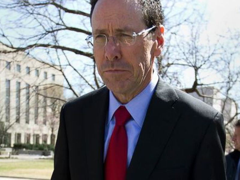 AT&T CEO Randall Stephenson leaves the federal courthouse in Washington. (AP)