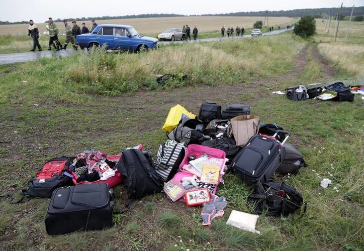 Muchos cuerpos y objetos de las víctimas fueron recuperados en campos de girasoles en el este de Ucrania. (AP)