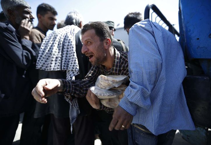 Douma was one of the first areas to rise up against President Bashar Assad's government and until a few weeks ago it was a major threat to his seat of power in Damascus. (AP).