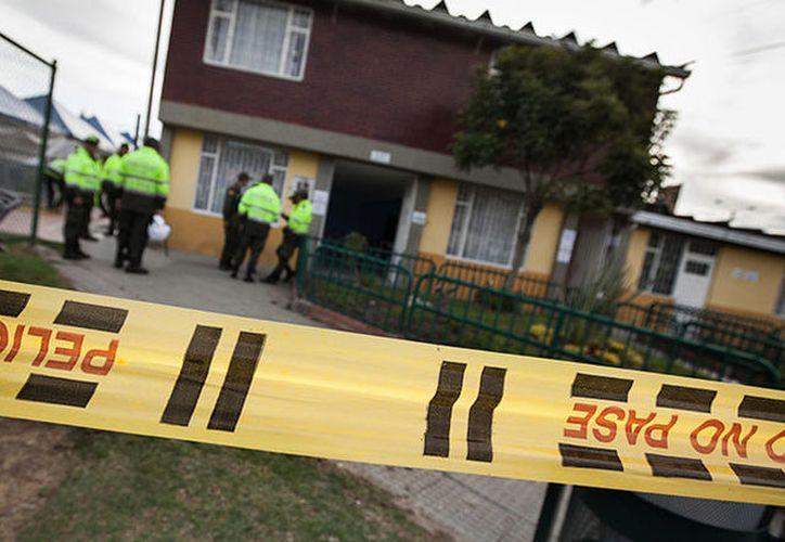El crimen ocurrió cuando la educadora se bajaba del taxi que la transportaba a la Institución Técnica San Miguel. (RT)