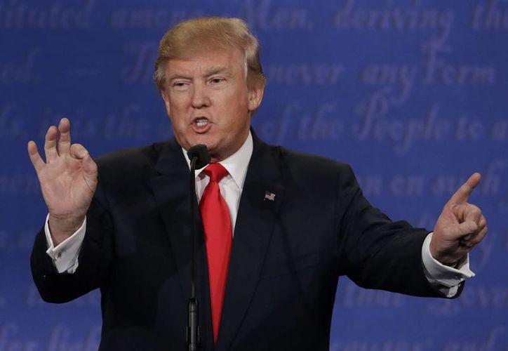 Durante su campaña, Donald Trump había sugerido la posibilidad de dejar su negocio en un fideicomiso administrado por sus tres hijos Ivanca, Eric y Donald Jr. (AP/David Goldman)