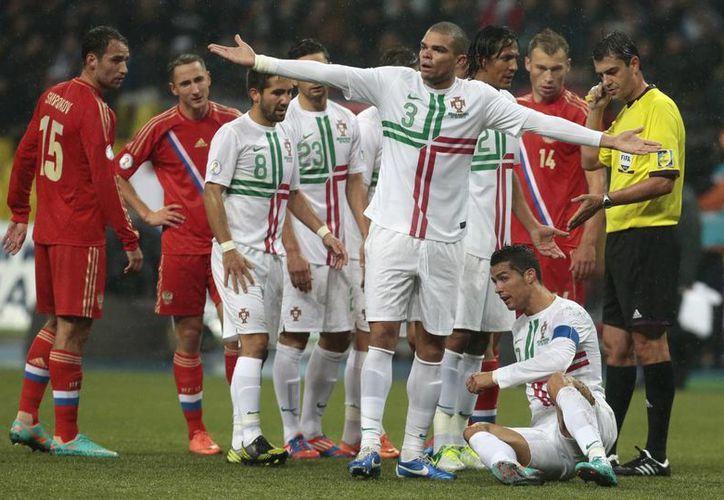 La de Cristiano Ronaldo, sería una de las ausencias más dolorosas del Mundial. (Foto: Archivo/AP)
