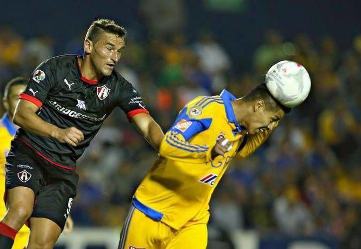 Tigres y Atlas repartieron puntos esta noche en la jornada 12 del Clausura 2016. (Imágenes/ Liga MX)