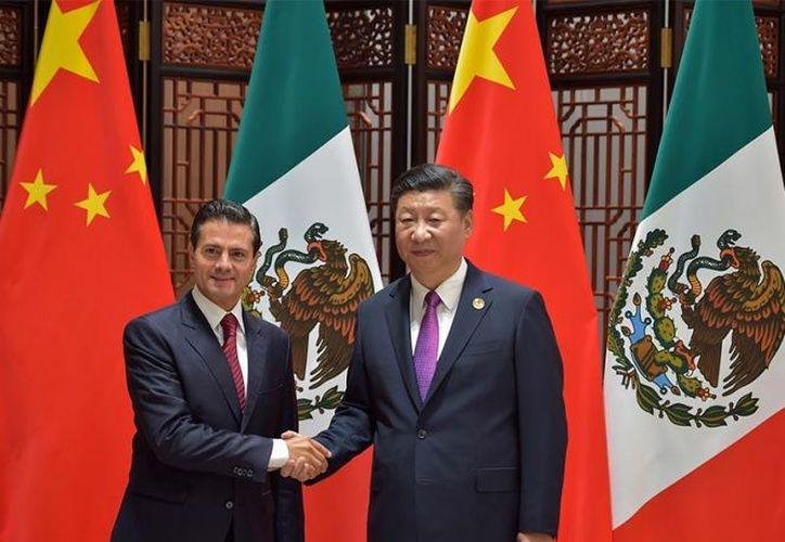 Enrique Peña Nieto y   Xi-Jinping. (Excelsior)