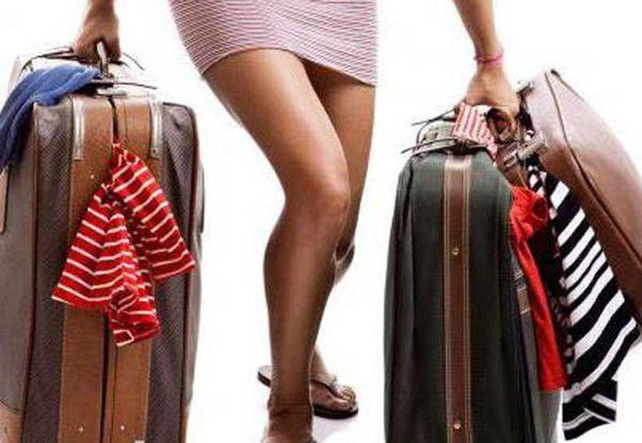 Si amas viajar saca las maletas y da una vuelta por toda la casa para ayudar a que tu deseo se cumpla. (glits.mx)