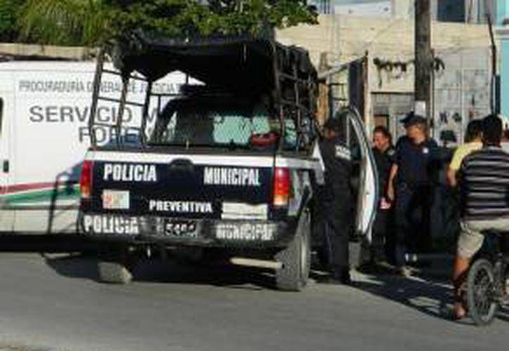 Las autoridades continúan investigando el crimen en la Región 228. (Eric Galindo/SIPSE)