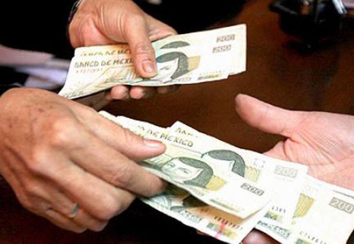 Hacer un pago con un billete falso se castiga hasta con 12 años de cárcel. (Milenio Novedades)
