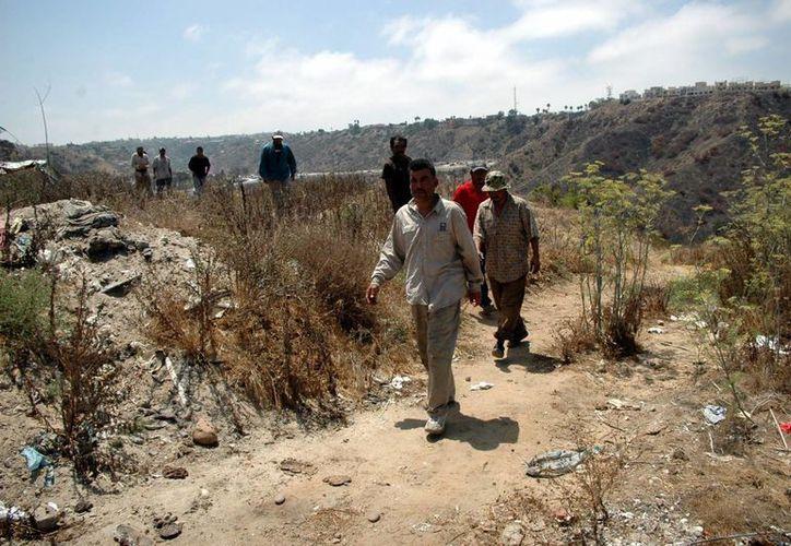 El tráfico de migrantes es uno de los delitos que se atribuyen a Mario Alberto Arce Moreno, identificado como líder de los Zetas. (Archivo/Notimex)