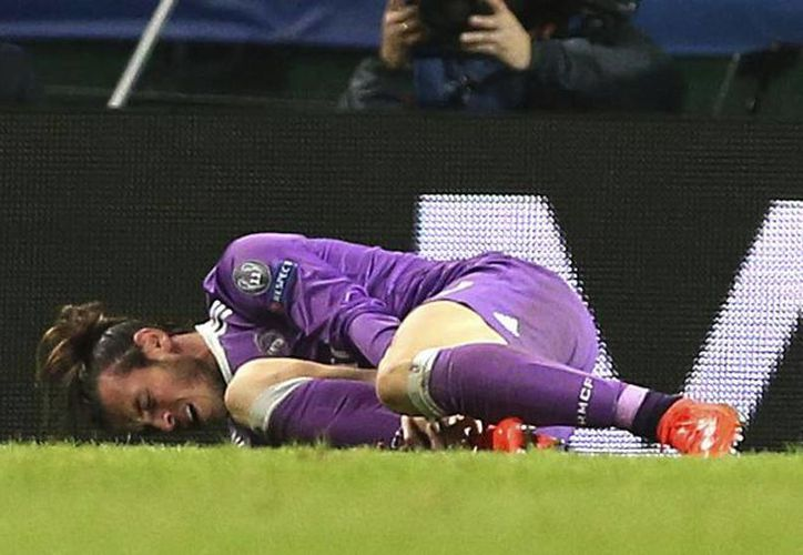 Gareth Bale sufrió la lesión en el juego ante el Sporting de Lisboa, el pasado martes, en la Champions League.(EFE)