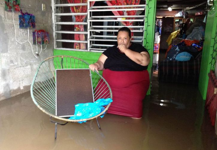 Las lluvias en Tabasco por el frente frío 20 han afectado las celebraciones de Navidad. (Notimex)
