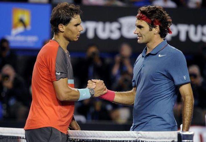 Rafael Nadal y Roger Federer se enfrentarán en la Final del Abierto de Australia, este domingo, a las 2:30 horas de la Ciudad de México.(Archivo/AP)
