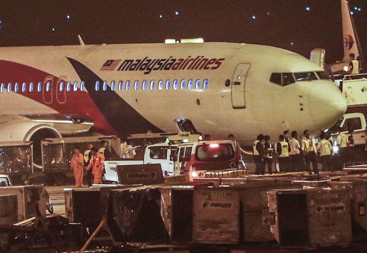 Los 166 pasajeros del vuelo de Malaysia Airlines están a salvo. (AP)