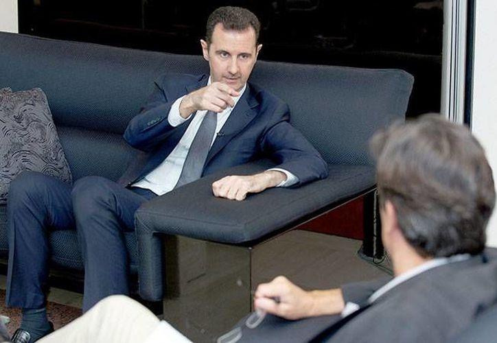 """Sil Occidente nos ataca """"se extenderán el caos y el extremismo"""" en la región, afirmo Bashar al Assad en entrevista con Le Figaro. (EFE)"""