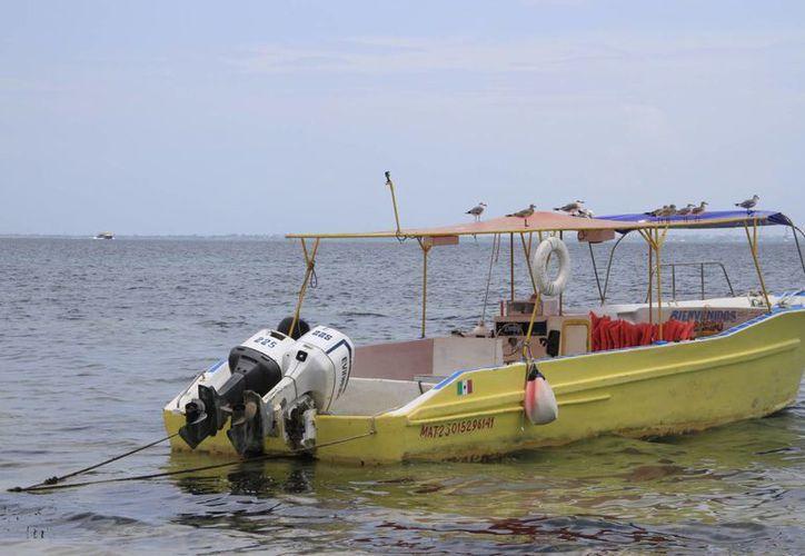 Los motores de embarcaciones necesitan mantenimiento preventivo. (Israel Leal/SIPSE)