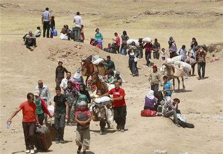 Dice que 44 mil refugiados han cruzado a la región curda del norte de Irak sólo desde el 15 de agosto. (Agencias)