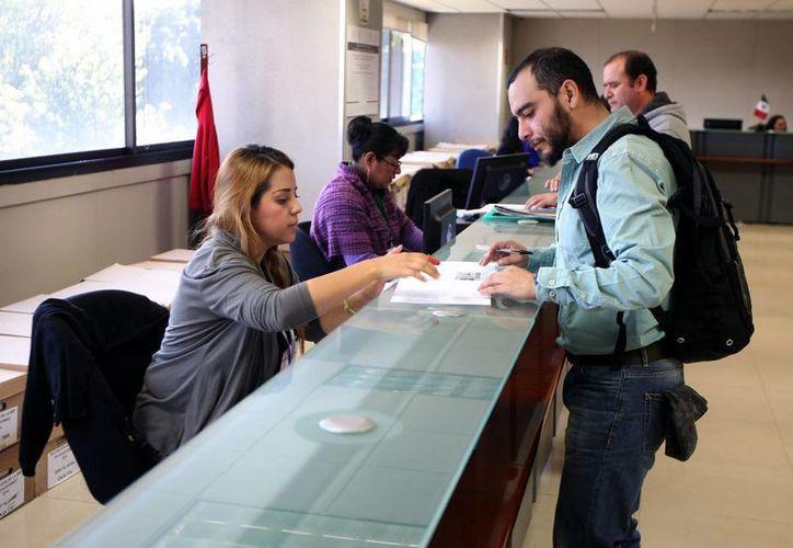 La emisión de pasaportes ya se regularizó en las 24 delegaciones del país. (Archivo/Notimex)