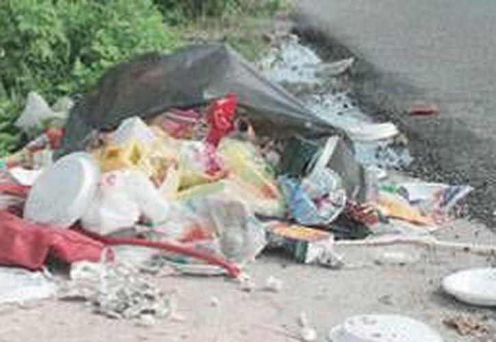 Al día en el municipio de Benito Juárez se recogen 900 toneladas de basura. (Redacción/SIPSE)