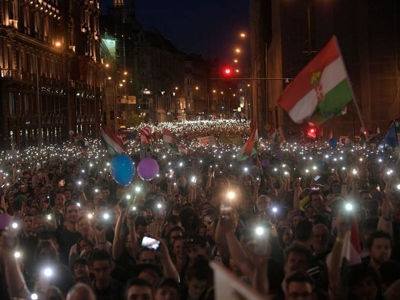 Thousands of people march during a protest in in Budapest, Hungary, against the distorting media policies of Prime Minister. (AP)