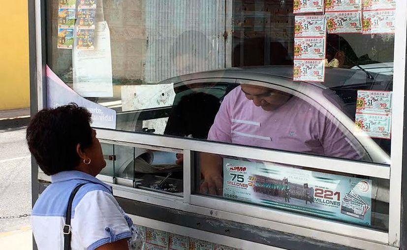 """Algunos yucatecos ganan premios en los sorteos, pero """"olvidan"""" cobrar sus premios. (Archivo/Milenio Novedades)"""