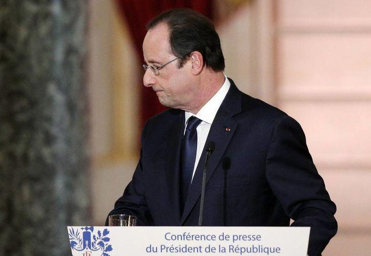 El presidente francés François Hollande prometió aclarar su situación personal antes de la visita que debe efectuar a Estados Unidos el 11 de febrero. (Agencias)
