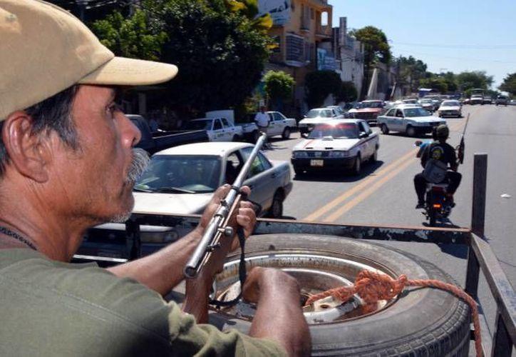 Calderón confía en que el crimen organizado no se infiltre en autodefensas en Michoacán, de donde es originario el expresidente. (Notimex/Archivo)