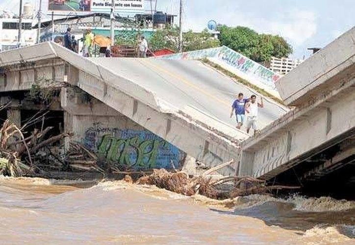 En el caso de los huracanes Ingrid y Manuel, el monto de los daños no puede sumarse. (Milenio).